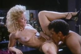 Retro licking pussy in bar