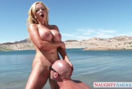 Blonde milf enjoys licking pussy on the beach